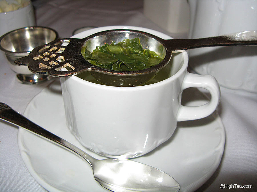 Japanese sencha green tea in tea strainer at Waldorf Astoria Hotel in New York City for afternoon tea