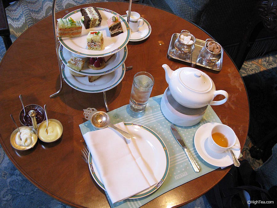 Table setting for afternoon tea at Ritz Carlton Chicago Hotel with three tier tray